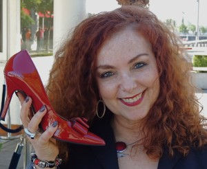 Mariela headshot with red shoe